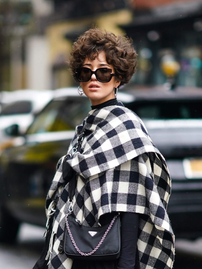 Street style picture of woman with short hair and curly hair in New York