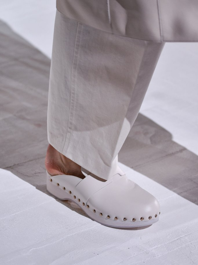 Details of clog shoes in taupe with rivets